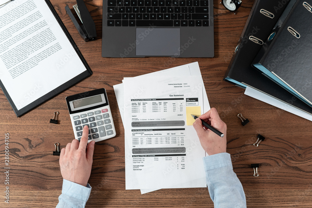 Fototapety, obrazy: Woman working behind wooden table in office