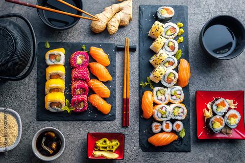 Recess Fitting Sushi bar Sushi Set sashimi and sushi rolls served on stone slate
