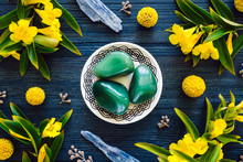 Green Aventurine With Blue Kyanite And Flowering Yellow Trumpet Vine On Blue Stained Wood