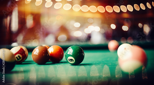 Colorful billiard balls on a billiard table. Fotobehang