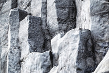 Natural Stone Texture. Basalt Lava Formations Like Columns. Icelandic Typical Natural Background. Reynisfjara Beach Volcanic Basalt Coloumn Formations In Iceland.