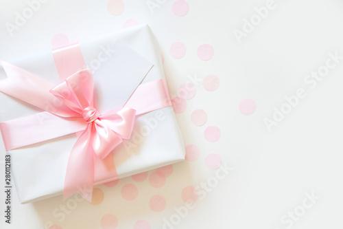 Fototapeta A gift for a girl. Pink satin ribbon with bow. obraz na płótnie