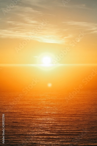 Fototapeta Vertical shot of a beautiful sea at sunset at Big Sur, California, USA obraz