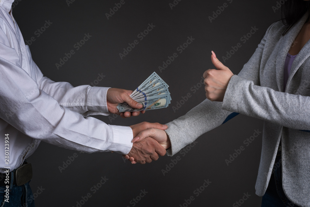 Fototapety, obrazy: Close up photo of man hands giving money to a woman. Succesfull deal between partners. ..money laundering. illegal cash transactions