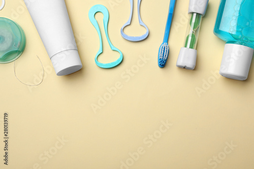Obraz na plátně  Flat lay composition with tongue cleaners and teeth care products on color background