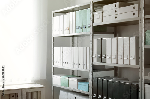 Photo Folders with documents on shelves in archive