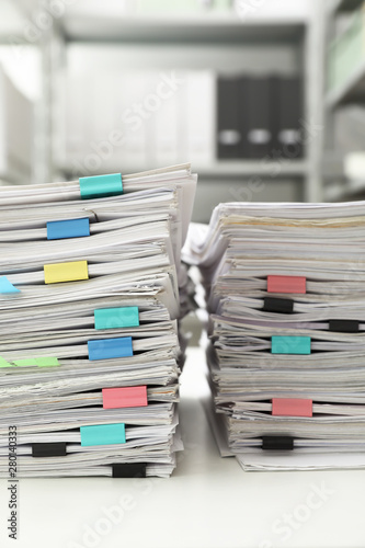 Stacks of documents with paper clips on office desk Canvas Print