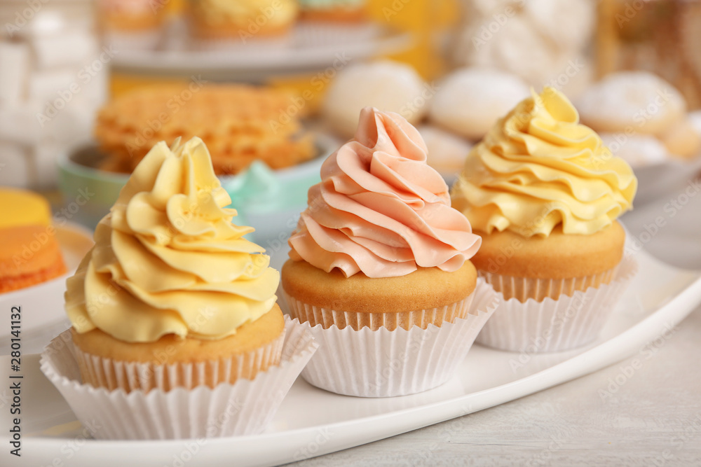 Fototapety, obrazy: Tasty cupcakes and other sweets on table. Candy bar, closeup view