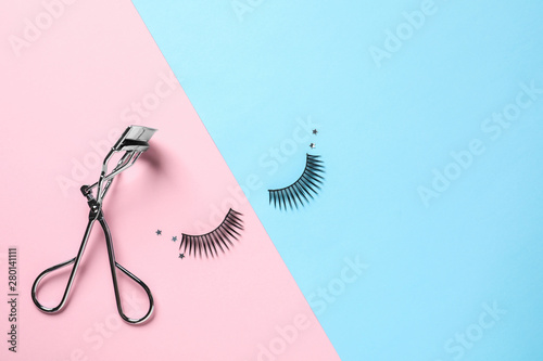 False eyelashes and curler on color background, flat lay Canvas Print