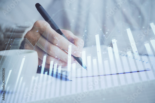 Foto auf AluDibond Orte in Europa Forex chart displayed on woman's hand taking notes background. Concept of research. Double exposure