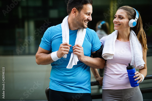 Obraz Fitness sporty couple relaxing after running training outside - fototapety do salonu