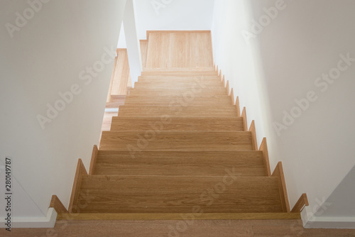 Foto auf Leinwand Treppe Wooden stairway in modern house from above