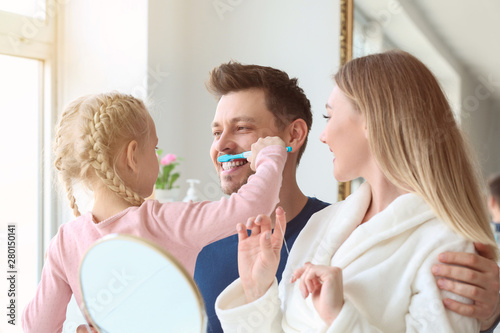 Fototapeta  Family cleaning teeth at home