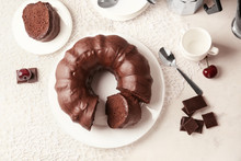 Plate With Tasty Chocolate Cake On Table