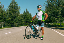 Athlete With Disabilities Or Amputee Training In Cycling In Sunny Summer's Day. Professional Male Sportsman With Leg Prosthesis Practicing Outdoors. Disabled Sport And Healthy Lifestyle Concept.