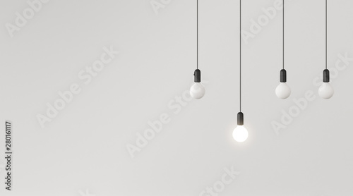 Fotografía  Mock up of hanging light bulbs with one glowing on white wall background,Conceptual idea,Outstanding