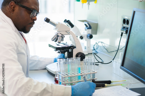 African-american man working in lab Fototapeta