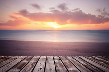 Colorful Beautiful Cloudy Sunset Over Ocean With Wooden Path