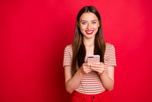 Photo Of Pretty Charming Funky Lady In Almost Total Red Look Holding Checking-in Her Flight On Smart Phone Isolated Bright Background