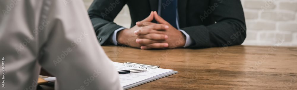 Fototapeta Businessmen having meeting for bribery and corruption