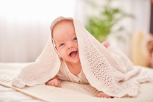 Baby Under The Towel. A Cheerf...