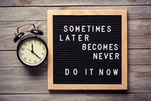 Inspirational Motivational Quote Sometimes Later Becomes Never. Do It Now Words On A Letter Board On Wooden Background Near Vintage Alarm Clock. Success And Motivation Concept.