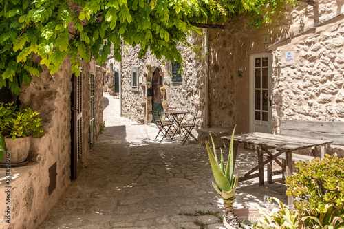 Mallorca - Shady place with tables and seats in Valldemossa
