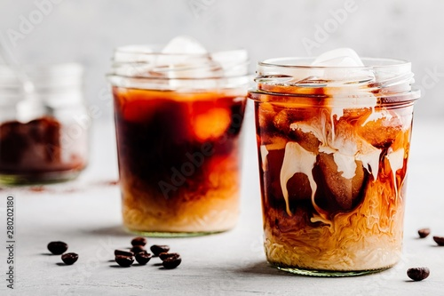 Leinwand Poster Almond Milk Cold Brew Coffee Latte in glass jars