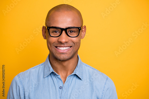 Obraz Photo of dark skin macho attractive appearance not smiling conference wear specs jeans denim shirt isolated bright yellow background - fototapety do salonu