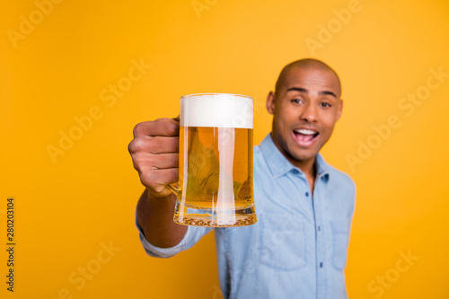 Poster Alcohol Photo of dark skin amazing guy hold hands beer glass let's celebrate expression wear jeans denim shirt isolated yellow background