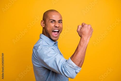 Valokuva  Profile photo of dark skin guy raise hands yell loud success achieve startup wea