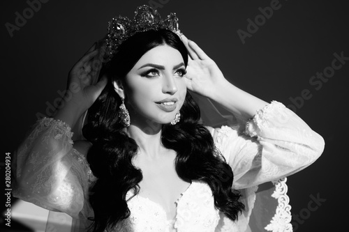Beautiful Bride Portrait wedding makeup and hairstyle, girl in diamonds tiara, jewelry model, fashion bride gorgeous beauty, smiling happy bride woman. Makeup and hairstyle in bride.  Black and white.