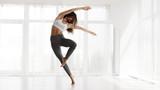 Girl Training Contemp In Modern Dance Studio. Copy Space