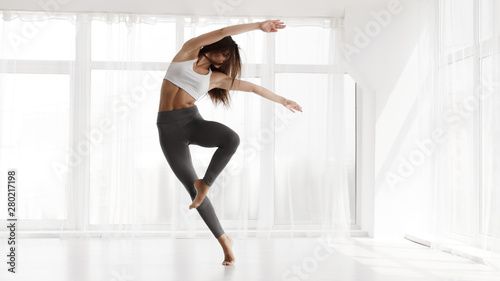 Girl Training Contemp In Modern Dance Studio. Copy Space