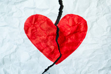 Broken Heart, Loss, Ended Relationship Or Cheating Concept. Sign Of Heart Drawn With A Marker Pen On A Piece Of Crumbled Torn Paper.