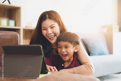 Photo  image of happy family at living room,happiness time of family playing at home,Mom and baby are happiness coexistence,happy family concept and Creating activities to strengthen skills for children