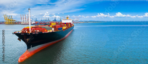 Fotografie, Obraz Aerial view container cargo ship carrying commercial container in import export business commerce logistic and transportation of international by container ship boat with copy space for banner web