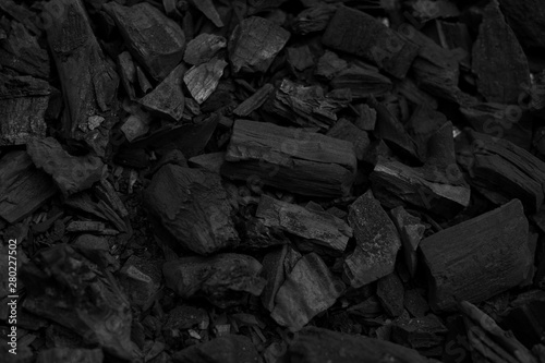 Cuadros en Lienzo Black charcoal pieces texture background for barbeque