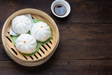 Steamed Dumplings Dim Sum In Bamboo Basket Steamer Chiness Style At Thai Restaurant, Steamed Stuff Bun On Wood Background