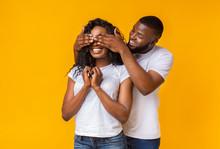 Black Guy Standing Behind His Girlfriend And Closing Her Eyes