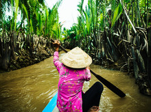 Traditional Vietnamese Boat Rowing Down The Mekong Delta, Vietnam, Southeast Asia