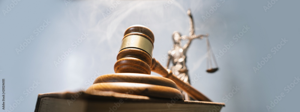 Fototapeta Statue of lady justice on bright background - Side view with copy space.