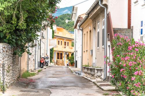 Fototapeten Schmale Gasse Crikvenica Croatia - July 2019: Crikvenica architecture lane