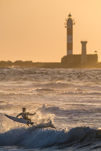 Surfing At The Lighthouse