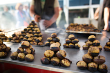 Roasted Chestnuts At A Street Vendor. Famous Turkish Street Food In Istanbul