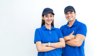 Portrait of smart happy delivery couple man woman isolated on white background, Young asian team wearing blue uniform. Delivery business teamwork concept