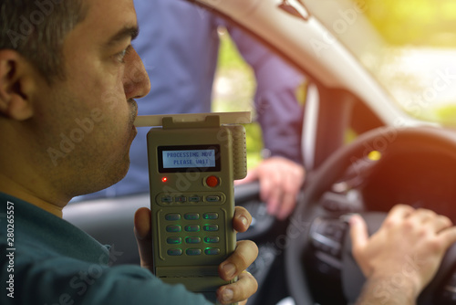 Fototapeta  Driver due to being subject to test for alcohol content with use of breathalyzer