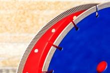 Diamond Cutting Discs For Granite And Reinforced Concrete On The Background Of Orange-golden Sandstone Walls.