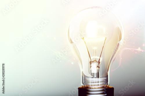 Glowing yellow light bulb, busienss idea concept Wallpaper Mural