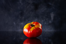 Tomato Front View On Dark Background